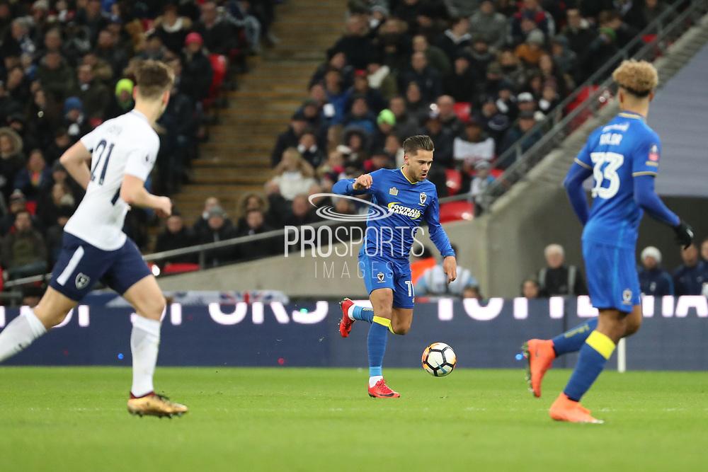 AFC Wimbledon attacker Harry Forrester (11) dribbling and starting an attack during the The FA Cup 3rd round match between Tottenham Hotspur and AFC Wimbledon at Wembley Stadium, London, England on 7 January 2018. Photo by Matthew Redman.