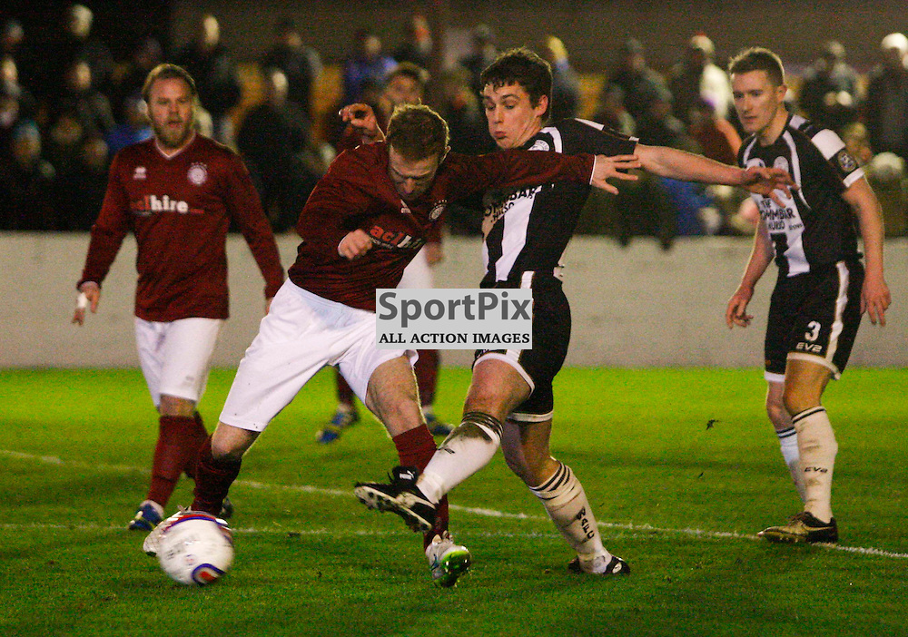 Wicks Michael Steven clears from Linlithgow midfielder Blair Batchelor during tonights William Hill Scottish Cup tie at Linlithgow