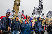 Stop the Bombing of Iraq - Don't Attack Syria Demonstration and march from Temple Place to Downing Street - here passing the Houses of Parliament.   Organised by the Stop the War Coalition. Westminster, London, UK 4 Oct 2014.