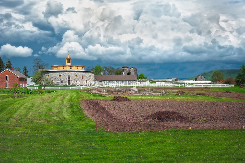 Hancock Shaker Village Farm with stormy sky