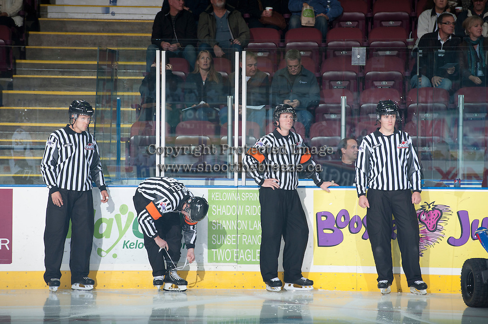 KELOWNA, CANADA - OCTOBER 22: WHL officials Dustin Minty, linesman, Mike Campbell, referee, Brett Iverson, referee and Ward Pateman, linesman, stand on the ice as the Calgary Flames visit the Kelowna Rockets on October 22, 2013 at Prospera Place in Kelowna, British Columbia, Canada.   (Photo by Marissa Baecker/Shoot the Breeze)  ***  Local Caption  ***