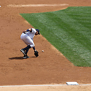 Alex Rodriguez making an error while fielding at third base during the New York Yankees V Detroit Tigers Major League Baseball regular season baseball game at Yankee Stadium, The Bronx, New York. 11th August 2013. Photo Tim Clayton