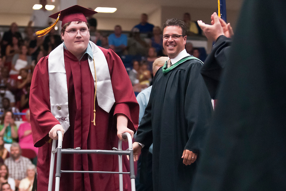 Lathan Goumas | MLive.com..Timothy Drost walks across stage to receive his diploma  during the 2012 Davison High School commencement ceremony at the Perani Arena in Flint, Mich. on Monday June 11, 2012.