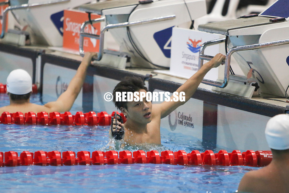 Dylan Koo reacts after his 50m butterfly race. (Photo © Chua Kai Yun/Red Sports)