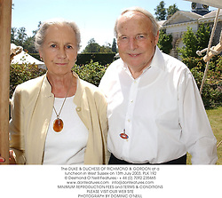 The DUKE & DUCHESS OF RICHMOND & GORDON at a luncheon in West Sussex on 13th July 2003.PLK 192
