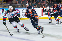 KELOWNA, BC - JANUARY 11: Dallon Wilton #15 of the Kelowna Rockets checks Tyler Carpendale #14 of the Kamloops Blazers as he skates with the puck at Prospera Place on January 11, 2020 in Kelowna, Canada. (Photo by Marissa Baecker/Shoot the Breeze)