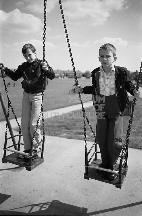 Gary and Nev on Swings, The Recc, Hedge lane, Palmers Green, UK, 1980s.