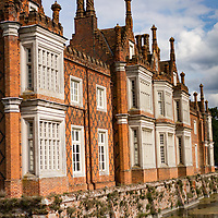 Exterior view of Helmingham Hall in Suffolk England in summer
