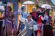 30 JUNE 2012 - PRESCOTT, AZ:  Participants in period outfits in the Prescott Frontier Days Rodeo Parade. The parade is marking its 125th year. It is one of the largest 4th of July Parades in Arizona. Prescott, about 100 miles north of Phoenix, was the first territorial capital of Arizona.    PHOTO BY JACK KURTZ