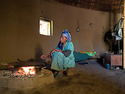 Sorse Likasa lights the fire at her home in Kotoba, Ethiopia.