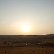 Oman, Wahiba Sands. January/25/2008...Nomadic Desert Camp in the morning light of the Wahiba Sands.