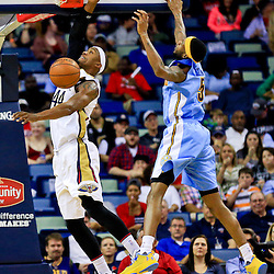 Mar 31, 2016; New Orleans, LA, USA; New Orleans Pelicans forward Dante Cunningham (44) dunks over Denver Nuggets guard JaKarr Sampson (9) during the first quarter of a game at the Smoothie King Center. Mandatory Credit: Derick E. Hingle-USA TODAY Sports