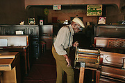 Mr. Timothy Louis Gates, Gates Piano Shop, Clarksdale, Mississippi. From the series Delta Dream.