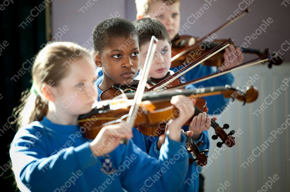 08.03.12<br /> Strings Specialist Dorothy Conaghan teaching violin to pupils at Holy Family School Ennis. David Atewologun.<br /> Pic. Alan Place / Press 22