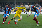 Wimbledon forward Joe Pigott (39) goes past Scunthorpe United defender Tom Pearce (16)  during the EFL Sky Bet League 1 match between Scunthorpe United and AFC Wimbledon at Glanford Park, Scunthorpe, England on 30 March 2019.