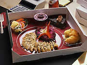 MEALS TO YOU--Sample tray of boxed food items served to in-flight airline crew and clients by gourmet caterer, Allentown,PA. 11041989