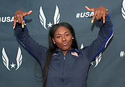 Apr 27, 2018; Philadelphia, PA, USA; Aaliyah Brown (USA) poses with an inverted Texas Longhorns sigh during the USA vs. The World press conference at the 124th Penn Relays at Franklin Field.