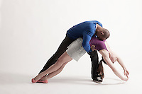 Man holds modern dance partner in position of loss