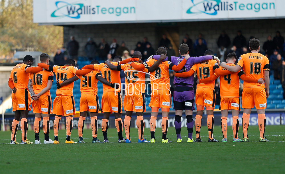 Colchester during the minute silence before the Sky Bet League 1 match between Millwall and Colchester United at The Den, London, England on 21 November 2015. Photo by Andy Walter.