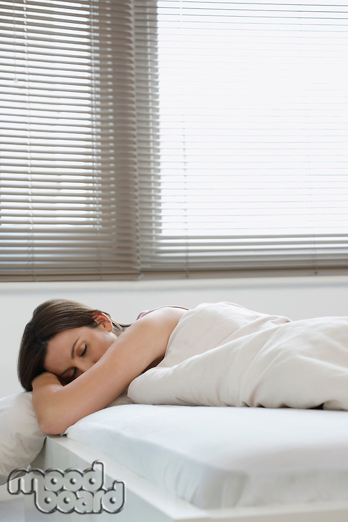 Young woman asleep in bed