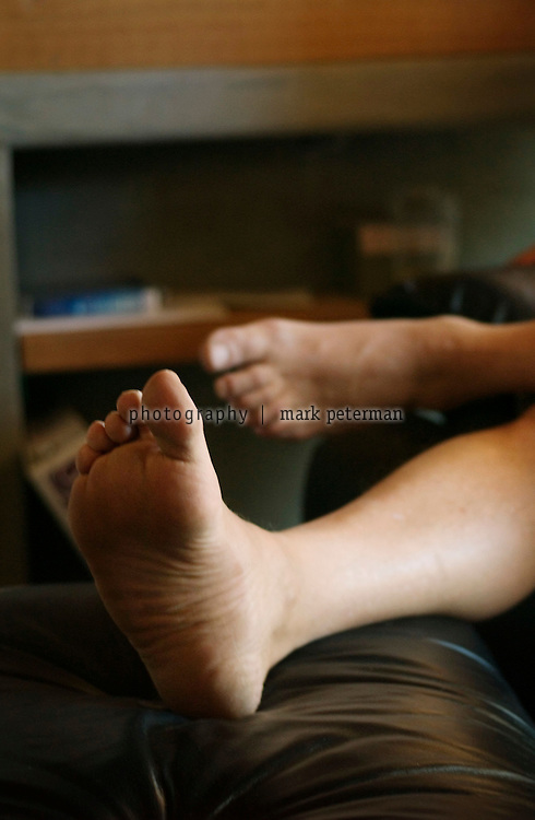 "Dr. Andrew Weil adheres to his ""no shoes"" policy while relaxing in the office of his ranch near Tucson, Arizona."