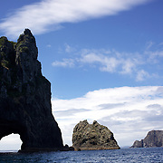 The hole in the rock viewed from the Excitor fast boat run by .Awesome Adventures from Paihia, Bay of Islands. 15th New Zealand, November 2010. Photo Tim Clayton.