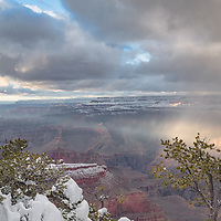 Sunbeams illuminate a portion of the valley below Yavapai Point, Grand Canyon National Park