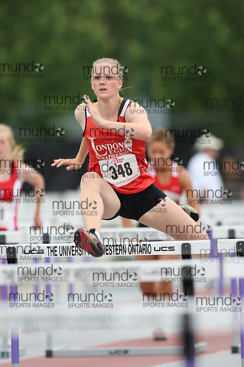 (London, Ontario---13/06/09)   Meghan Harris of London Legion T&F Alliance competes in the  sprint hurdles at the 2009 Athletics Ontario Junior Track and Field Championships. The meet was held in London, Ontario from June 13-14, 2009. Copyright photograph Sean Burges / Mundo Sport Images, 2009. www.mundosportimages.com / www.msievents.