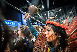 11 December 2019, Madrid, Spain: Daira Tukano, an indigenous woman from the Tukano nation in Northeast Brazil, shakes a maraca, as hundreds of civil society and other actors hold an unauthorized protest outside the plenary hall of COP25 in Madrid, to draw attention to the failures of the climate talks and to call on rich countries to step up and pay up for real solutions, and to highlight the threat of loopholes, false solutions like carbon markets, and the need for those who caused the climate crisis to pay up for loss and damage while respecting human rights.