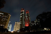 The Tokyo Metropolitan Government offices are illuminated with red lights to mark World AIDS Day in Tokyo, Japan on Tuesday Nov. 30 2010..Photographer: Robert Gilhooly