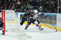 KELOWNA, CANADA - FEBRUARY 18: Turner Elson #10 of the Red Deer Rebels checks Tyson Baillie #4 of the Kelowna Rockets as the Red Deer Rebels visit the Kelowna Rockets on February 18, 2012 at Prospera Place in Kelowna, British Columbia, Canada (Photo by Marissa Baecker/Shoot the Breeze) *** Local Caption ***