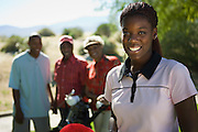 Woman Golfing with Family
