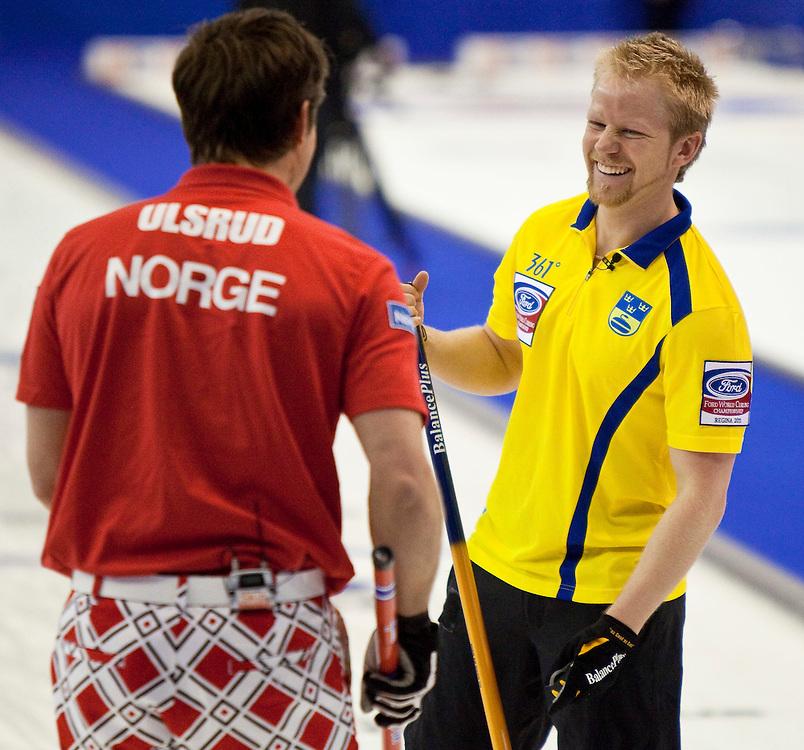 Swedish skip Niklas Edin, right, shares a laugh Norway skip Thomas Ulsrud during their bronze medal match at the Ford World Men's Curling Championships in Regina, Saskatchewan, April 10, 2011.<br /> AFP PHOTO/Geoff Robins