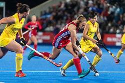 Erica Sanders of Great Britain Women is watched by Bingfeng Gu of China Women during the 2019 Women's FIH Pro League match at Lee Valley Hockey Centre, Stratford<br /> Picture by Simon Parker/Focus Images Ltd <br /> 03/05/2019