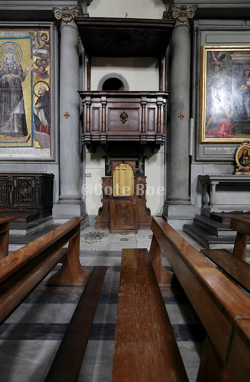 confessional in a richly decorated church Italy