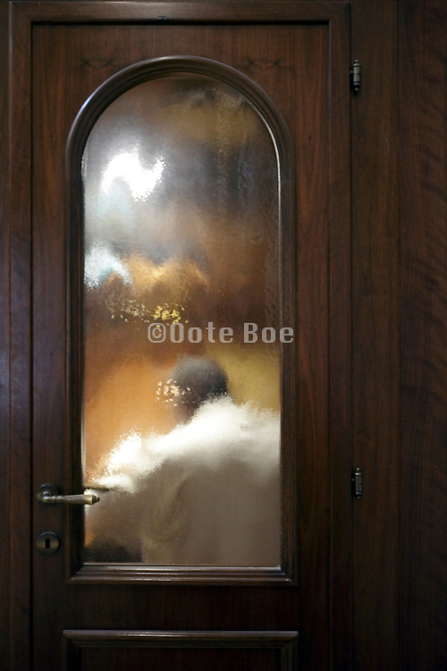 close up of a person sitting in a confessional Italy