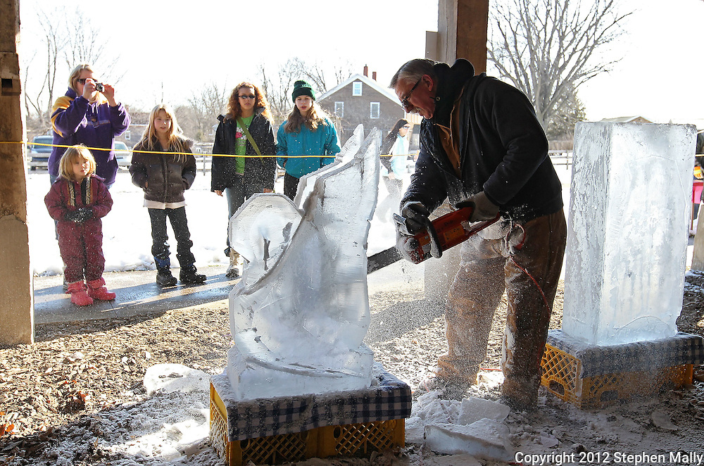 Mercy executive chef Ron Hall works on an ice sculpture during Winterfest at the Market Barn in Amana on Saturday, January 28, 2012. Activities included the Best Beard Competition, winter wreath toss, the Great Amana Ham-Put, hammerschlagen, and a log sawing competition. (Stephen Mally/Freelance)