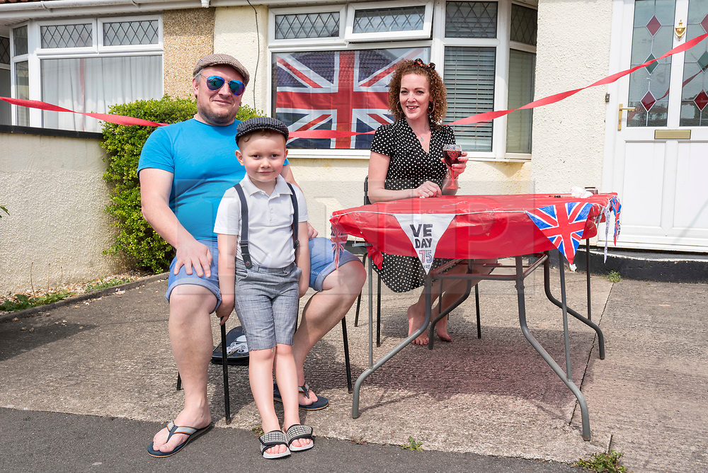 © Licensed to London News Pictures; 08/05/2020; Bristol, UK. Lee Bradford, Jax aged 5 and Chantelle Bradford at VE Day 75th anniversary celebrations of the end of the second world war in Europe, combined with the 50th birthday of Lee Carswell. Lee had planned to have his birthday in Las Vegas but that was cancelled due to the Covid-19 coronavirus pandemic. So Lee is having his birthday with his neighbours in Novers Park Road, with a street party and bunting. Photo credit: Simon Chapman/LNP.