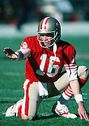 San Francisco 49ers quarterback Joe Montana (16) prepares to take the long snap from center during the NFC Divisional Playoff NFL football game against the Minnesota Vikings on January 1, 1989 in San Francisco, CA. The 49ers won the game 34-9.  ©Paul Anthony Spinelli