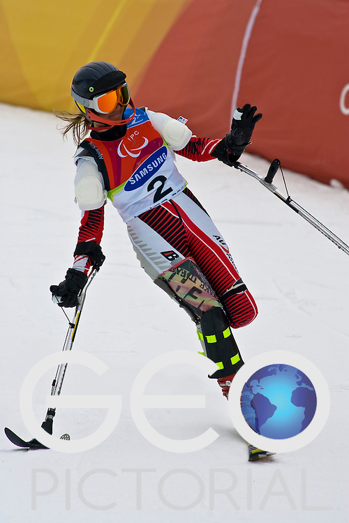 SESTRIERE COLLE, ITALY - MARCH  18th : Danja Haslacher (LW2) of Austria finishes her second run of the Womens Alpine Skiing Slalom Standing competition on Day 9 of the 2006 Turin Winter Paralympic Games on March 16th, 2006 in Sestriere Borgata, Italy.