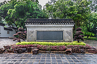 stone plate with park history at Kowloon Walled City Park in Hong Kong