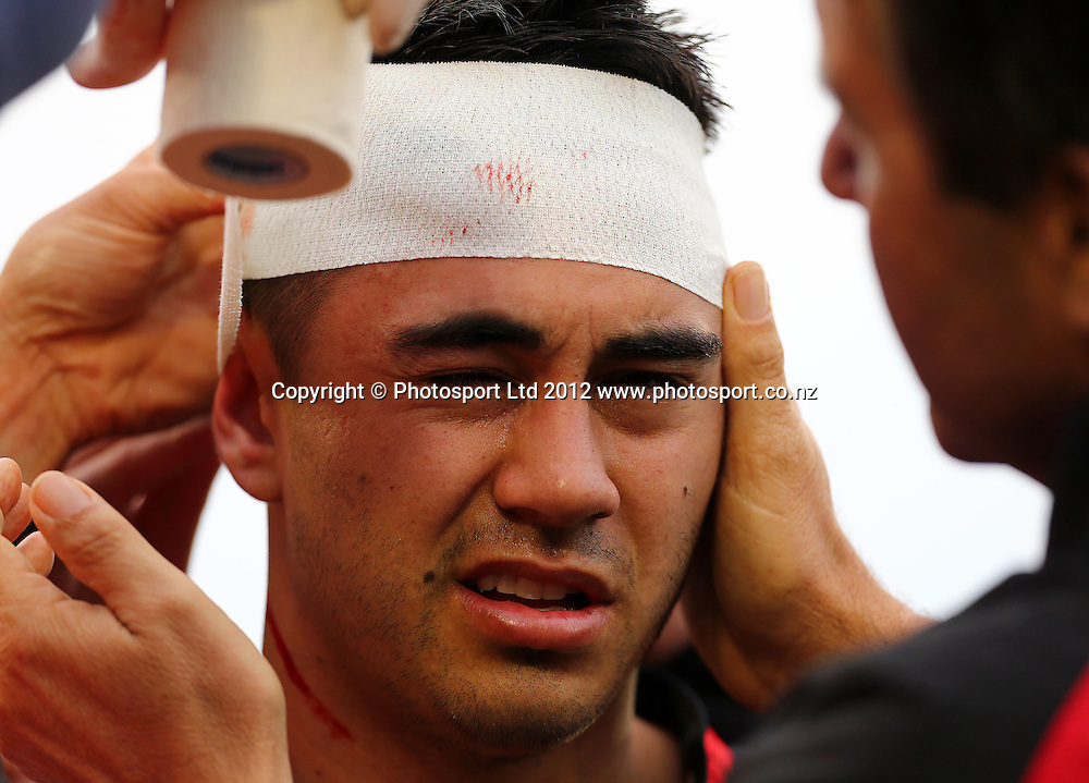 Shaun Johnson of the Warriors recieves attention for a head wound during the NRL game, Vodafone Warriors v Penrith Panthers, Mt Smart Stadium, Auckland, Sunday 19 August  2012. Photo: Simon Watts /photosport.co.nz