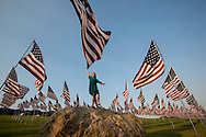 Helleney Avila, 9, poses for photos on the top of a rock amongst 3,000 US flags are displayed at Pepperdine University to mark the 12th anniversary of the 9/11 terror attack, September 10, 2013 in Malibu, California. Photo by Ringo Chiu/PHOTOFORMULA.com)