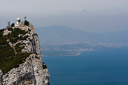 A panoramic view from the top of the Rock of Gibraltar looking north, looking towards Spain. Images of Gibraltar, the British overseas territory located on the southern end of the Iberian Peninsula at the entrance of the Mediterranean.