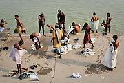 Morning bathers at the Ganges River or the Great Mother, one of the holiest rivers in India.  Everyday about 60,000 people bathe in it (Varanasi, India).