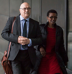 © Licensed to London News Pictures. 20/02/2018. London, UK.  Oxfam CEO, MARK GOLDRING and Oxfam International executive director WINNIE BYANYIMA arrive at Portcullis House in London where Oxfam bosses are due to give evidence to an International Development Select Committee. The group will respond to allegations that prostitutes were hired by Oxfam workers during a humanitarian mission in Haiti. Photo credit: Ben Cawthra/LNP