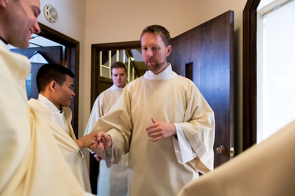 DENVER, CO - MAY 13: Daniel Ciucci shakes the hand of another man before his ordination to the priesthood at the Cathedral Basilica of the Immaculate Conception on May 13, 2017, in Denver, Colorado. (Photo by Daniel Petty/for Denver Catholic)