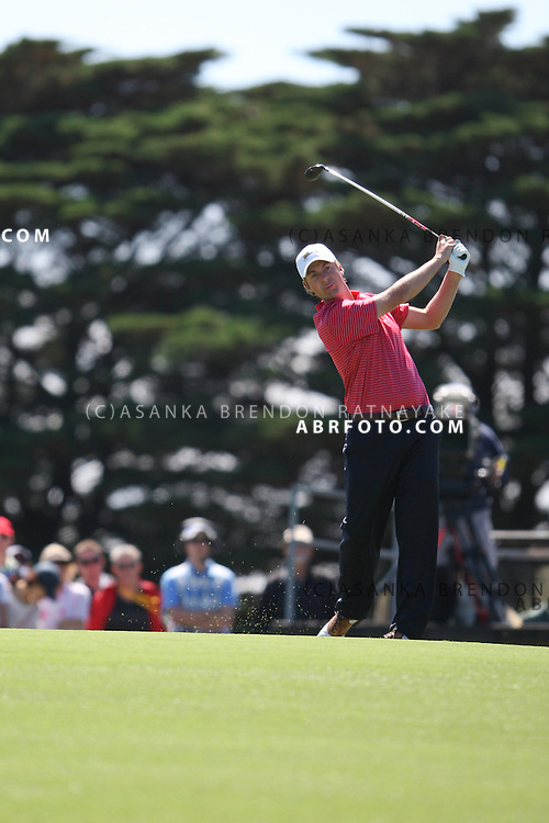 20 November 2011 : American Webb Simpson plays a wood approach shot on the 2nd hole during the fifth-round Sunday Final round single ball matches at the Presidents Cup at the Royal Melbourne Golf Club in Melbourne, Australia. .