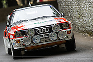 Chichester, UK - July 2013: Audi Quattro passes the flint wall in action at the Goodwood Festival of Speed on July 12, 2013.