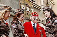 A World War II veteran gets a visit by the Victory Belles at the National WWII Museum in New Orleans, LA.